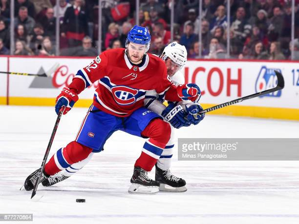 Jonathan Drouin of the Montreal Canadiens skates the puck against Patrick Marleau of the Toronto Maple Leafs during the NHL game at the Bell Centre...