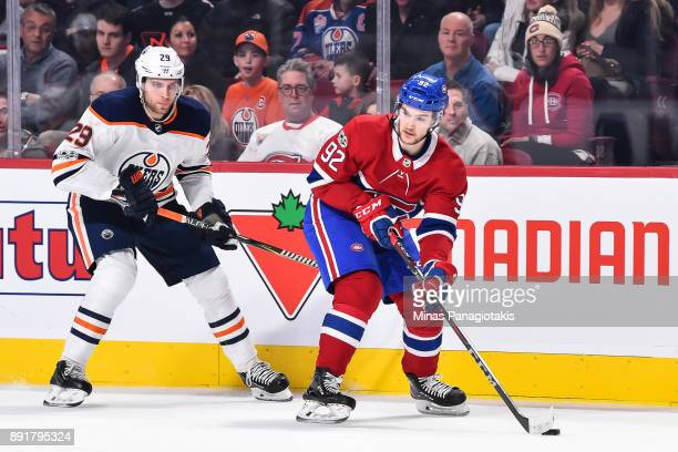 Jonathan Drouin of the Montreal Canadiens skates the puck against Leon Draisaitl of the Edmonton Oilers during the NHL game at the Bell Centre on...