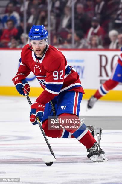 Jonathan Drouin of the Montreal Canadiens skates the puck against the Toronto Maple Leafs during the NHL game at the Bell Centre on October 14 2017...