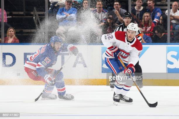 Jonathan Drouin of the Montreal Canadiens skates with the puck against Mika Zibanejad of the New York Rangers at Madison Square Garden on October 8...