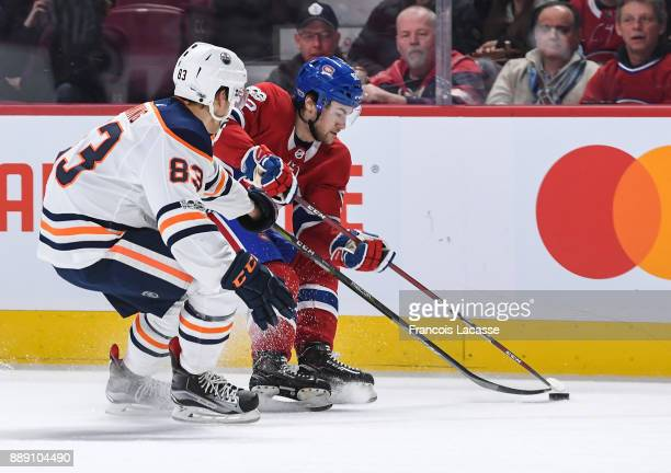 Jonathan Drouin of the Montreal Canadiens skates with the puck under pressure from Matt Benning of the Edmonton Oilers in the NHL game at the Bell...