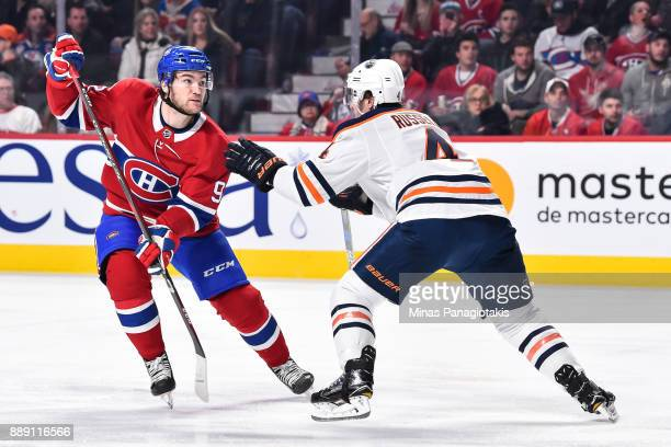 Jonathan Drouin of the Montreal Canadiens tries to skate past Kris Russell of the Edmonton Oilers during the NHL game at the Bell Centre on December...