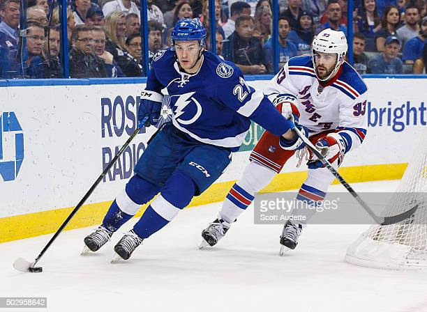 Jonathan Drouin of the Tampa Bay Lightning carries the puck against Keith Yandle of the New York Rangers during the second period at the Amalie Arena...