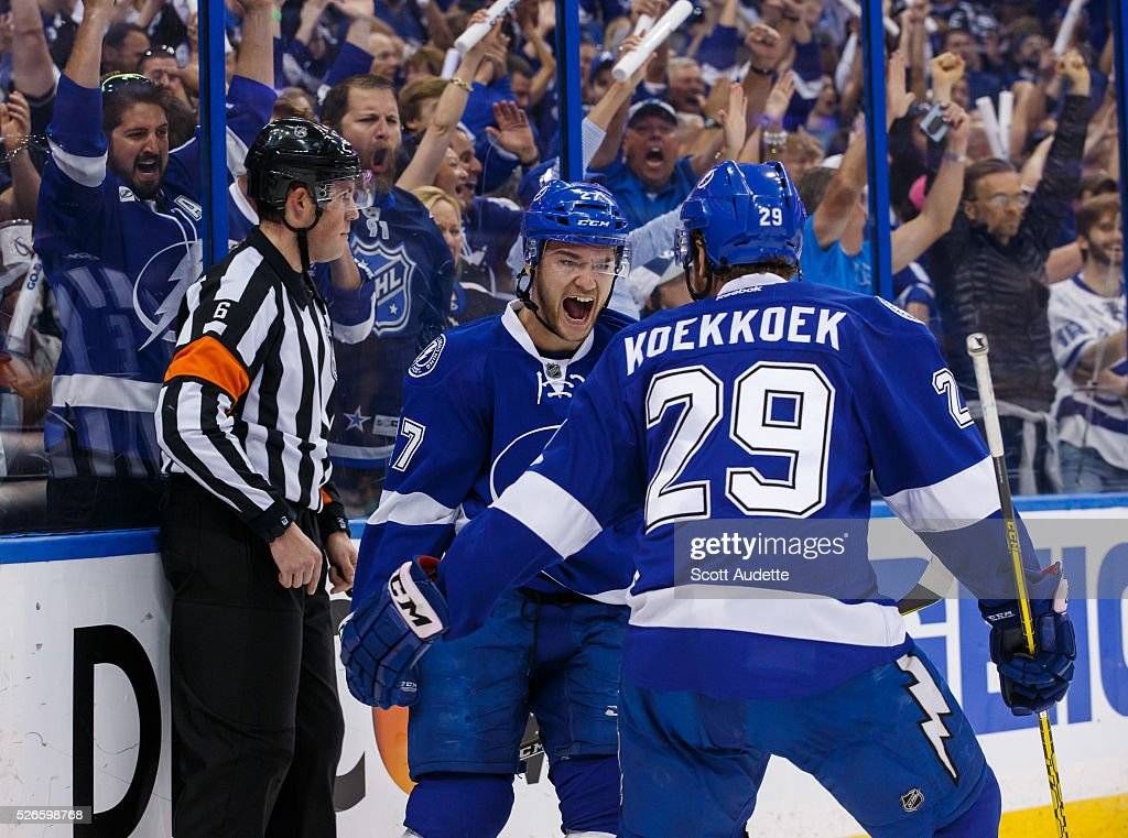 <a gi-track='captionPersonalityLinkClicked' href=/galleries/search?phrase=Jonathan+Drouin+-+Ice+Hockey+Player&family=editorial&specificpeople=10884241 ng-click='$event.stopPropagation()'>Jonathan Drouin</a> #27 of the Tampa Bay Lightning celebrates his goal with teammate <a gi-track='captionPersonalityLinkClicked' href=/galleries/search?phrase=Slater+Koekkoek&family=editorial&specificpeople=7406937 ng-click='$event.stopPropagation()'>Slater Koekkoek</a> #29 against the New York Islanders during the first period of Game Two of the Eastern Conference Second Round in the 2016 NHL Stanley Cup Playoffs at the Amalie Arena on April 30, 2016 in Tampa, Florida.