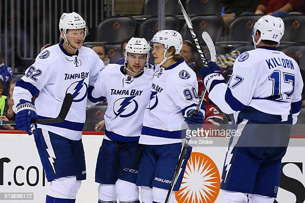 Jonathan Drouin of the Tampa Bay Lightning celebrates his third period goal with Vladislav Namestnikov and Andrej Sustr against the New Jersey Devils...