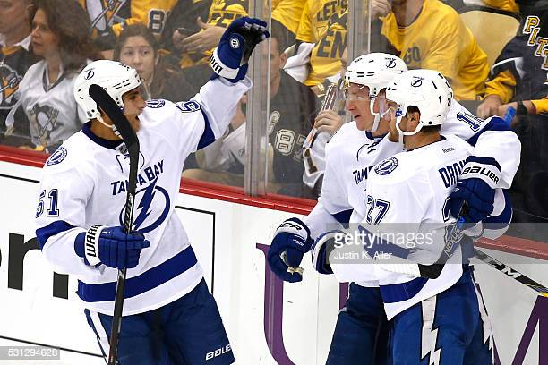 Jonathan Drouin of the Tampa Bay Lightning celebrates with his teammates after scoring a goal in the second period against Matt Murray of the...