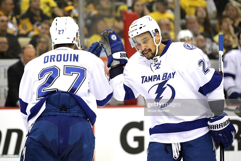 <a gi-track='captionPersonalityLinkClicked' href=/galleries/search?phrase=Jonathan+Drouin+-+Ice+Hockey+Player&family=editorial&specificpeople=10884241 ng-click='$event.stopPropagation()'>Jonathan Drouin</a> #27 of the Tampa Bay Lightning celebrates with his teammate <a gi-track='captionPersonalityLinkClicked' href=/galleries/search?phrase=J.T.+Brown+-+Ice+Hockey+Player&family=editorial&specificpeople=10853804 ng-click='$event.stopPropagation()'>J.T. Brown</a> #23 after scoring a goal against Matt Murray #30 of the Pittsburgh Penguins during the first period in Game Two of the Eastern Conference Final during the 2016 NHL Stanley Cup Playoffs at the Consol Energy Center on May 16, 2016 in Pittsburgh, Pennsylvania.
