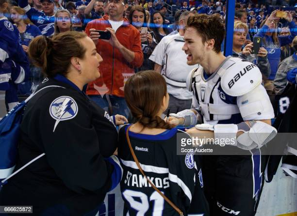 Jonathan Drouin of the Tampa Bay Lightning gives a fan his game worn jersey after the win against the Buffalo Sabres at Amalie Arena on April 9 2017...