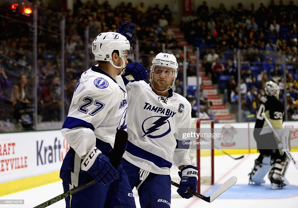 <a gi-track='captionPersonalityLinkClicked' href=/galleries/search?phrase=Jonathan+Drouin+-+Ice+Hockey+Player&family=editorial&specificpeople=10884241 ng-click='$event.stopPropagation()'>Jonathan Drouin</a> #27 of the Tampa Bay Lightning is congratulated by teammate <a gi-track='captionPersonalityLinkClicked' href=/galleries/search?phrase=Steven+Stamkos&family=editorial&specificpeople=4047623 ng-click='$event.stopPropagation()'>Steven Stamkos</a> #91 as goaltender Matthew Murray #30 of the Pittsburgh Penguins reacts during the second period of the NHL Kraft Hockeyville USA preseason game on September 29, 2015 at the Cambria County War Memorial Arena in Johnstown, Pennslyvania.
