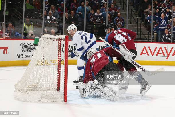 Jonathan Drouin of the Tampa Bay Lightning scores the game winner against goaltender Calvin Pickard of the Colorado Avalanche at the Pepsi Center on...