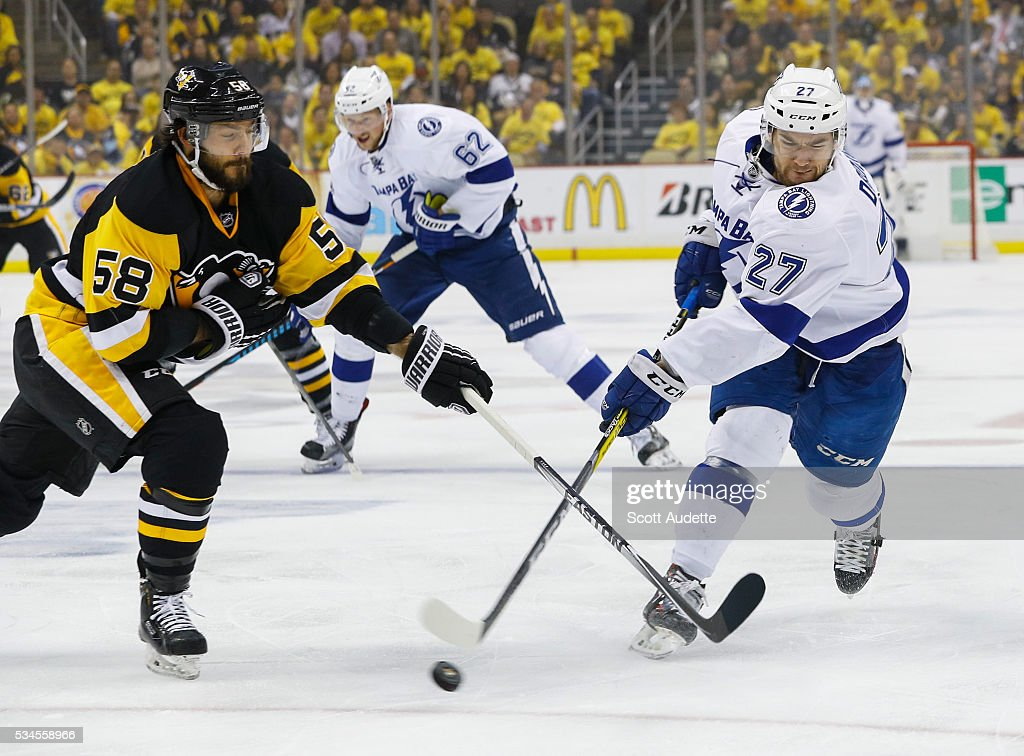 <a gi-track='captionPersonalityLinkClicked' href=/galleries/search?phrase=Jonathan+Drouin+-+Ishockeyspelare&family=editorial&specificpeople=10884241 ng-click='$event.stopPropagation()'>Jonathan Drouin</a> #27 of the Tampa Bay Lightning shoots against <a gi-track='captionPersonalityLinkClicked' href=/galleries/search?phrase=Kris+Letang&family=editorial&specificpeople=3966336 ng-click='$event.stopPropagation()'>Kris Letang</a> #58 of the Pittsburgh Penguins during the first period of Game Seven of the Eastern Conference Finals in the 2016 NHL Stanley Cup Playoffs at the Amalie Arena on May 26, 2016 in Tampa, Florida.