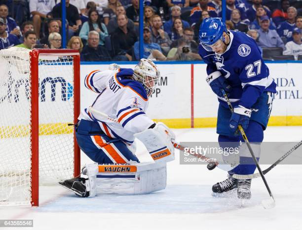 Jonathan Drouin of the Tampa Bay Lightning skates against goalie Laurent Brossoit of the Edmonton Oilers during the first period at Amalie Arena on...