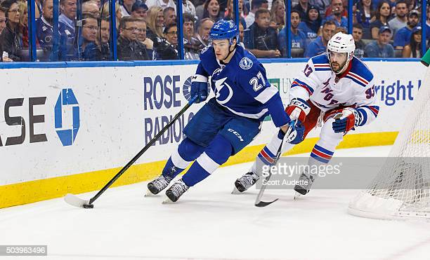 Jonathan Drouin of the Tampa Bay Lightning skates against Keith Yandle of the New York Rangers during the third period at the Amalie Arena on...
