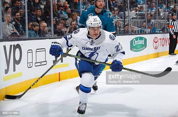Jonathan Drouin of the Tampa Bay Lightning skates against Paul Martin of the San Jose Sharks at SAP Center on December 5 2015 in San Jose California