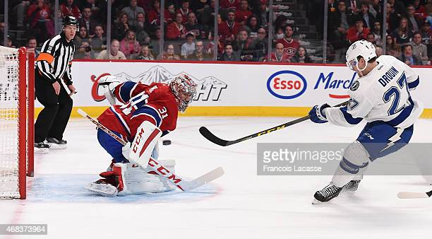 Jonathan Drouin of the Tampa Bay Lightning takes a shot on Carey Price of the Montreal Canadiens in the NHL game at the Bell Centre on March 30 2015...
