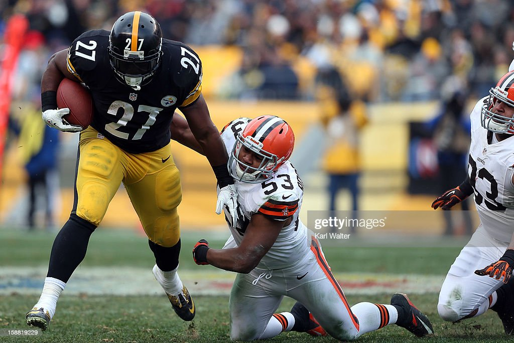 Jonathan Dwyer #27 of the Pittsburgh Steelers breaks a tackle by Craig Robertson #53 of the Cleveland Browns during their game at Heinz Field on December 30, 2012 in Pittsburgh, Pennsylvania.