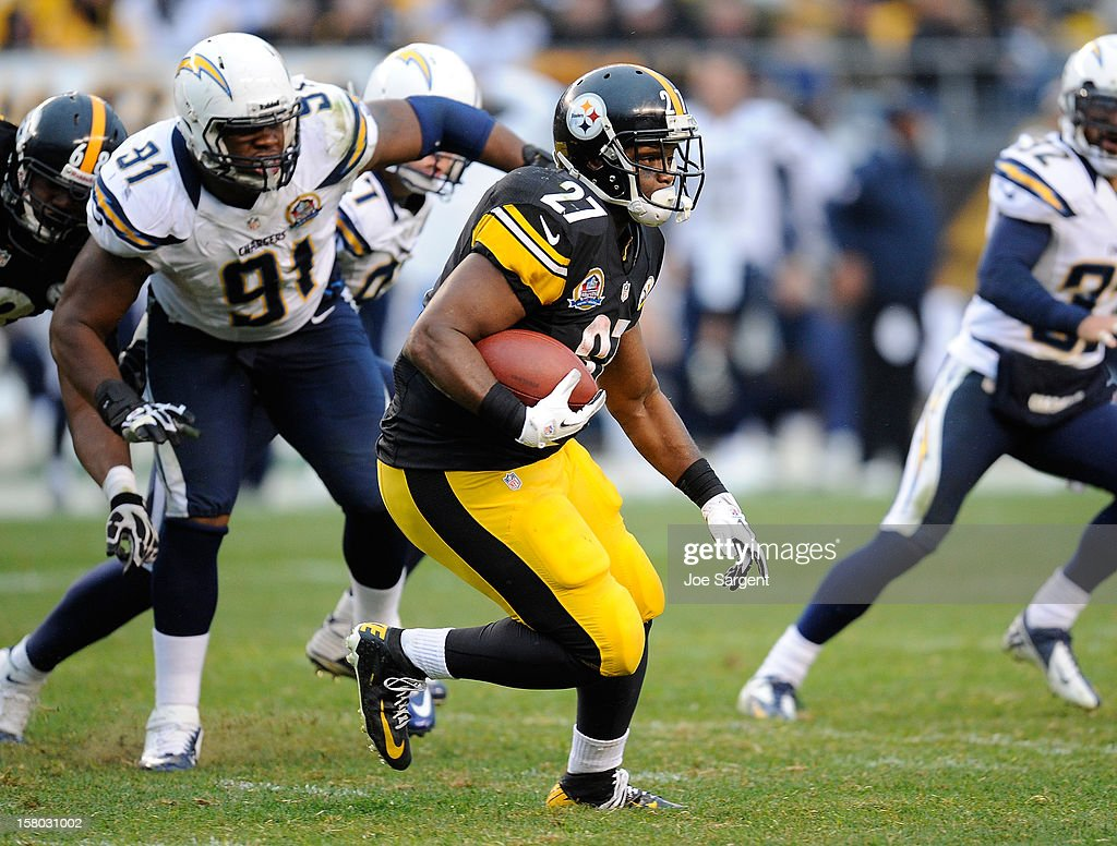 Jonathan Dwyer #27 of the Pittsburgh Steelers carries the ball in front of Kendall Reyes #91 of the San Diego Chargers on December 9, 2012 at Heinz Field in Pittsburgh, Pennsylvania.