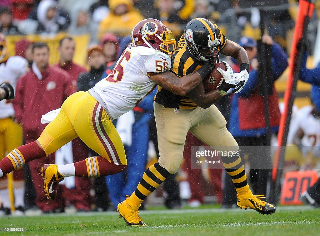 <a gi-track='captionPersonalityLinkClicked' href=/galleries/search?phrase=Jonathan+Dwyer&family=editorial&specificpeople=4501112 ng-click='$event.stopPropagation()'>Jonathan Dwyer</a> #27 of the Pittsburgh Steelers is dragged down by Perry Riley #56 of the Washington Redskins on October 28, 2012 at Heinz Field in Pittsburgh, Pennsylvania. Pittsburgh won the game 27-12.