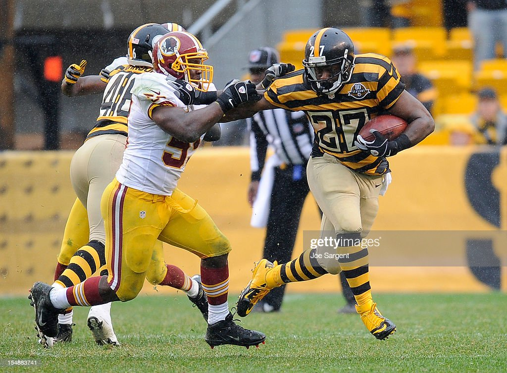 <a gi-track='captionPersonalityLinkClicked' href=/galleries/search?phrase=Jonathan+Dwyer&family=editorial&specificpeople=4501112 ng-click='$event.stopPropagation()'>Jonathan Dwyer</a> #27 of the Pittsburgh Steelers stiff arms <a gi-track='captionPersonalityLinkClicked' href=/galleries/search?phrase=London+Fletcher&family=editorial&specificpeople=223941 ng-click='$event.stopPropagation()'>London Fletcher</a> #59 of the Washington Redskins during the third quarter on October 28, 2012 at Heinz Field in Pittsburgh, Pennsylvania. Pittsburgh won the game 27-12.