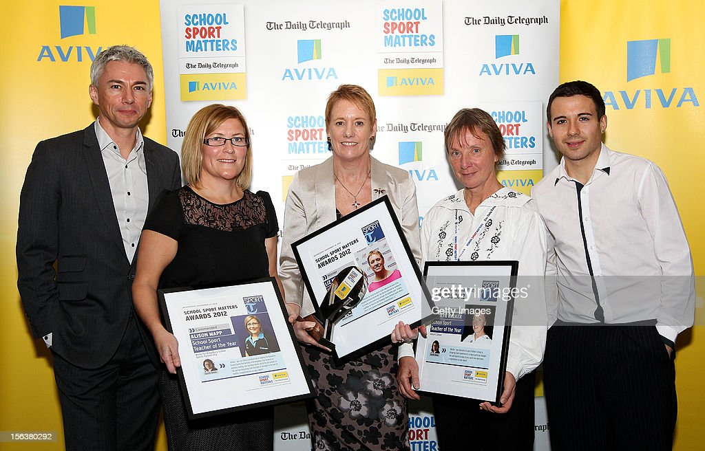 Jonathan Edwards (L) and Will Bayley (R) pose with School Sport Teacher of the Year nominees during the AVIVA and Daily Telegraph School Sport Matters awards at Lord's Cricket Ground on November 14, 2012 in London, England.