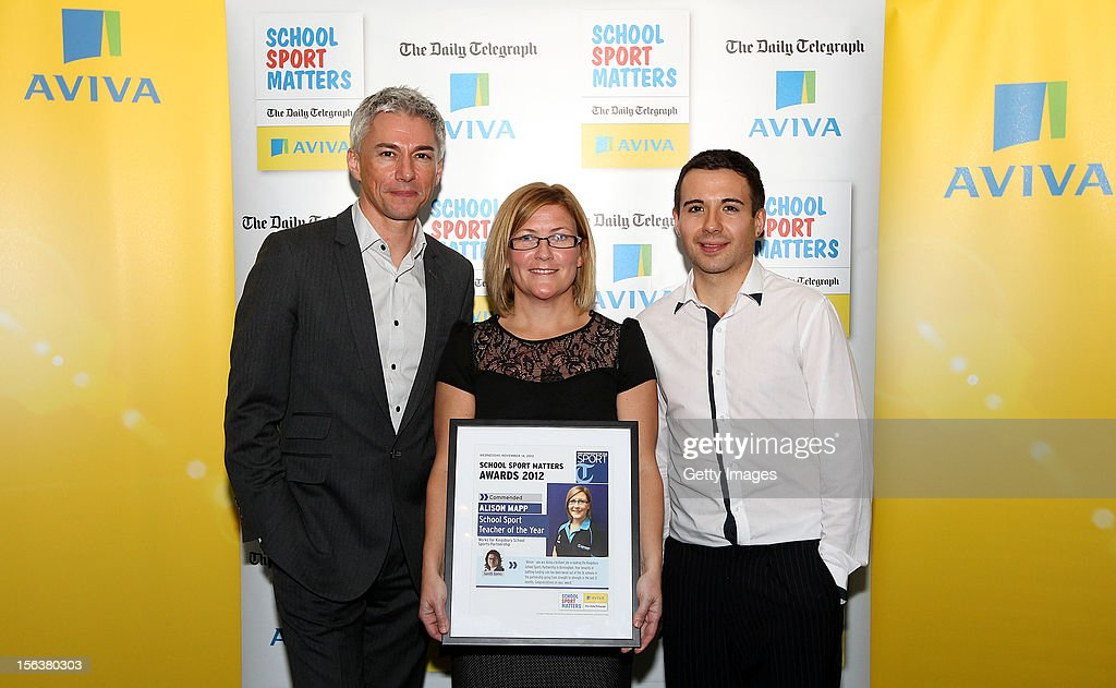Jonathan Edwards (L) and Will Bayley (R) pose with School Sport Teacher of the Year commended nominee Alison Mapp during the AVIVA and Daily Telegraph School Sport Matters awards at Lord's Cricket Ground on November 14, 2012 in London, England.