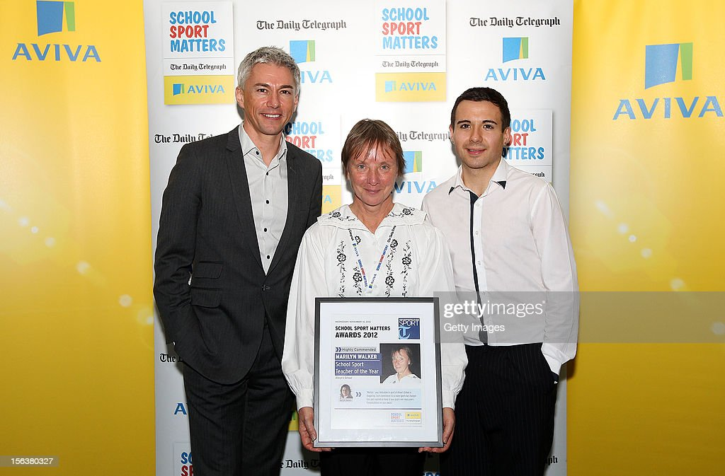 Jonathan Edwards (L) and Will Bayley (R) pose with School Sport Teacher of the Year highly commended nominee Marilyn Walker during the AVIVA and Daily Telegraph School Sport Matters awards at Lord's Cricket Ground on November 14, 2012 in London, England.