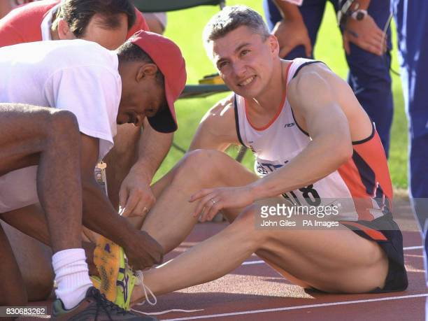 Jonathan Edwards receiving treatment after seeing his attempt at a Triple Jump World Record end on the run up as he collapsed while making his final...