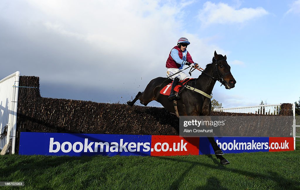 Jonathan England riding Cloudy Too clear the last to win The Colin Parker Memorial Intermediate Steeple Chase at Carlisle racecourse on November 03, 2013 in Carlisle, England.
