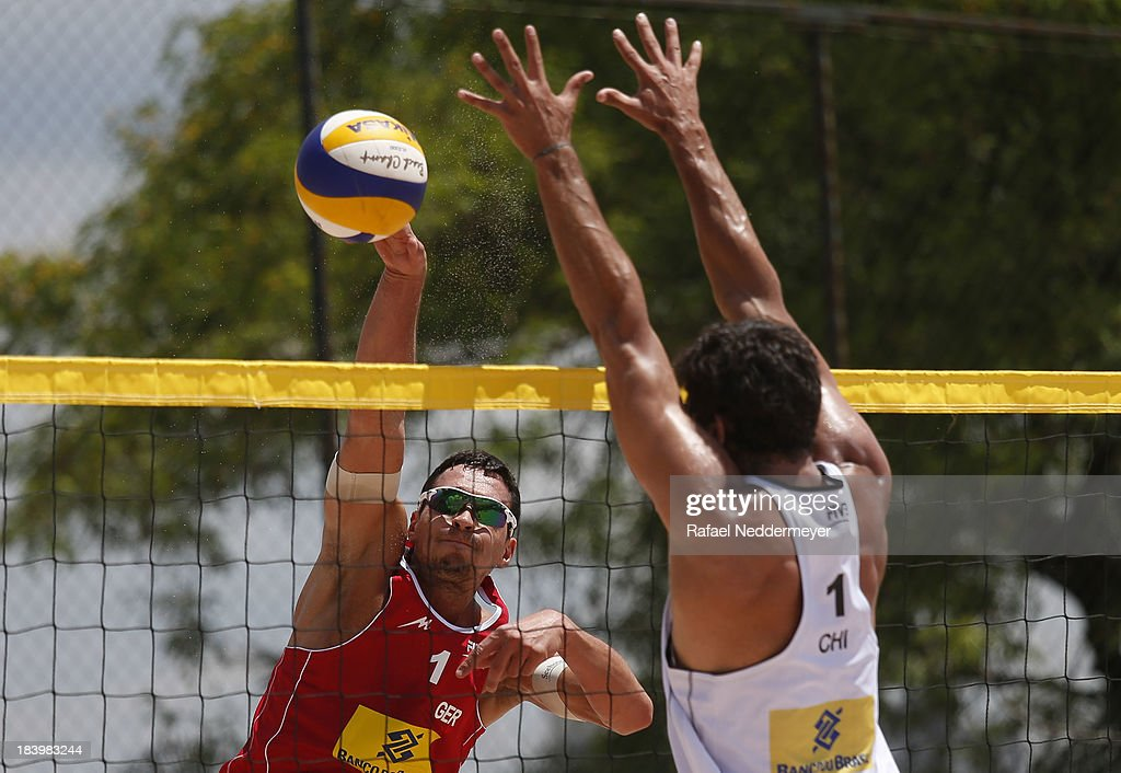 Jonathan Erdmann of Germany and Marco Grimalt of Chile (R) in action during day third of the FIVB Beach Volleyball Sao Paulo Grand Slam 2013 at Parque Villa Lobos on October 10, 2013 in Sao Paulo, Brazil.
