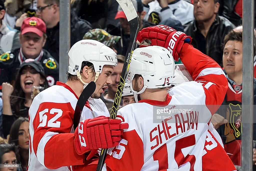 Jonathan Ericsson and Riley Sheahan of the Detroit Red Wings celebrate after the Red Wings scored against the Chicago Blackhawks in the second period...