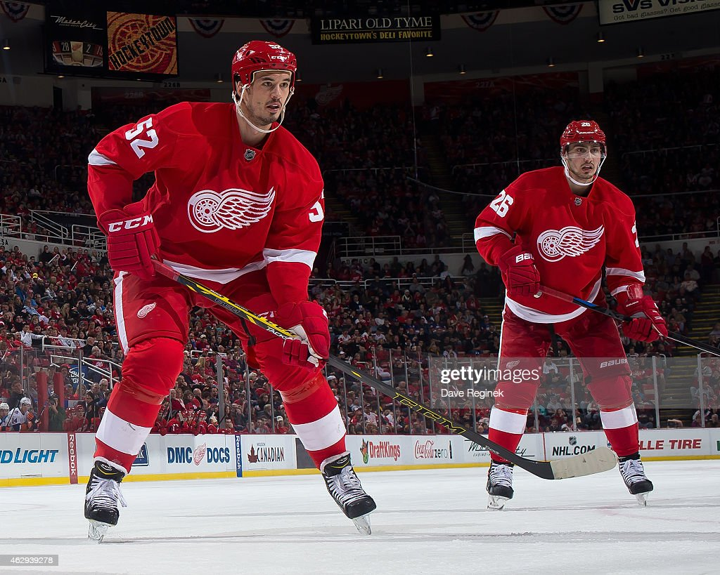 Jonathan Ericsson and Tomas Jurco of the Detroit Red Wings follows the play during a NHL game against the New York Islanders on January 31 2015 at...
