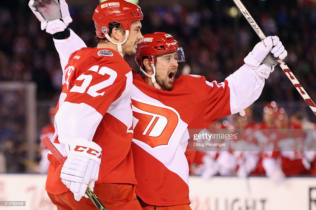 Jonathan Ericsson #52 and Tomas Tatar #21 of the Detroit Red Wings celebrate Tatar's first period goal against the Colorado Avalanche at Coors Field during the 2016 Coors Light Stadium Series game on February 27, 2016 in Denver, Colorado.