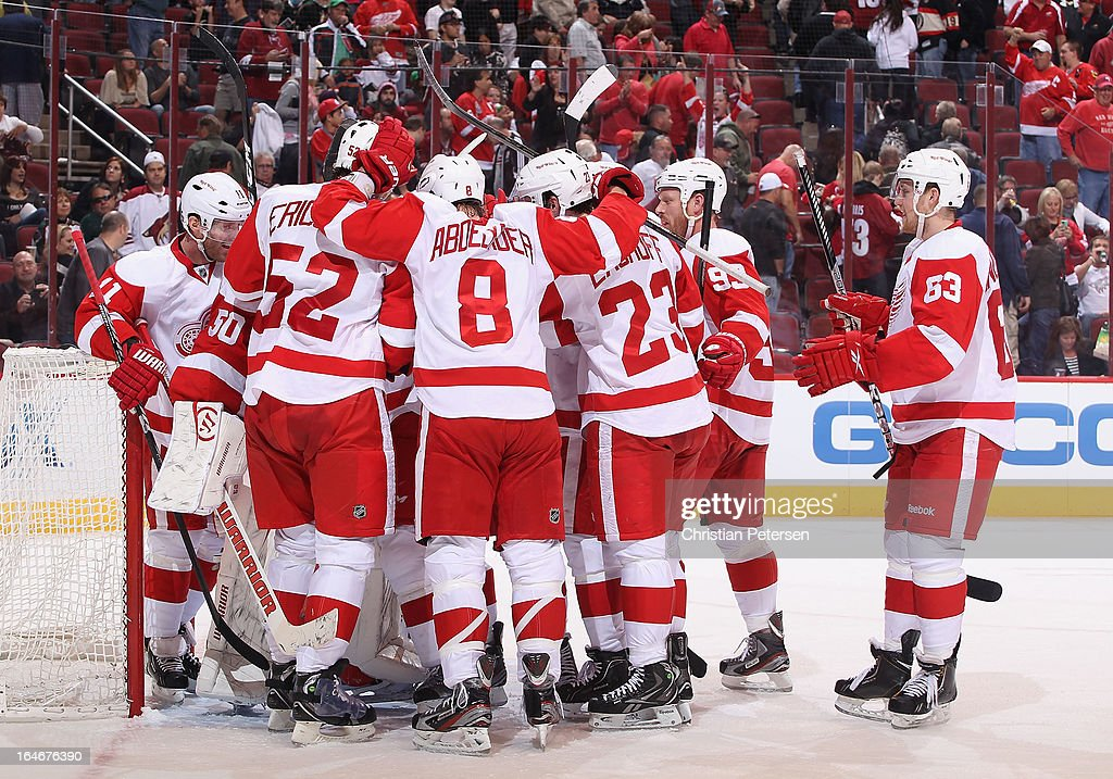 Jonathan Ericsson #52, Justin Abdelkader #8, Brian Lashoff #23, Joakim Andersson #63 and the Detroit Red Wings celebrate around goaltender Jonas Gustavsson after defeating the Phoenix Coyotes in NHL game at Jobing.com Arena on March 25, 2013 in Glendale, Arizona. The Red Wings defeated the Coyotes 3-2.