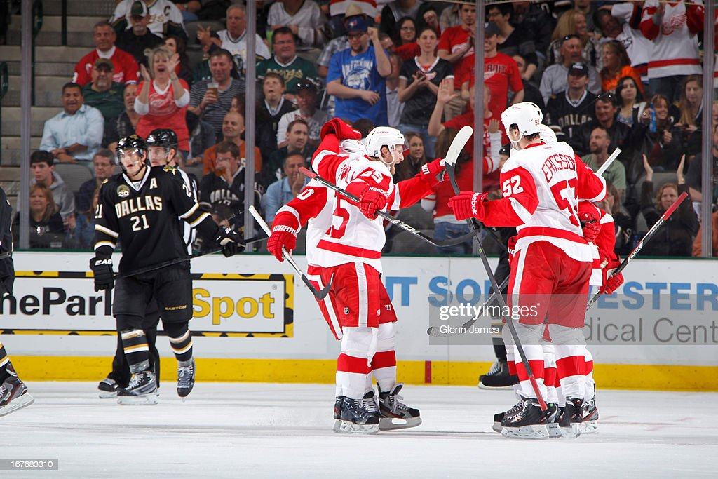 Jonathan Ericsson #52, Niklas Kronwall #55 and the Detroit Red Wings celebrate a goal against the Dallas Stars at the American Airlines Center on April 27, 2013 in Dallas, Texas.
