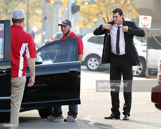 Jonathan Ericsson of the Detroit Red Wings arrives in the players lot before an NHL game against the Vancouver Canucks at Joe Louis Arena on October...