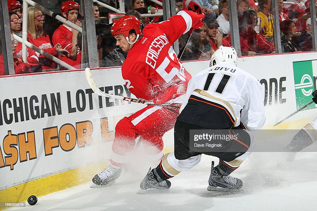 <a gi-track='captionPersonalityLinkClicked' href=/galleries/search?phrase=Jonathan+Ericsson&family=editorial&specificpeople=2538498 ng-click='$event.stopPropagation()'>Jonathan Ericsson</a> #52 of the Detroit Red Wings battles for the puck with <a gi-track='captionPersonalityLinkClicked' href=/galleries/search?phrase=Saku+Koivu&family=editorial&specificpeople=202253 ng-click='$event.stopPropagation()'>Saku Koivu</a> #11 of the Anaheim Ducks during Game Three of the Western Conference Quarterfinals at Joe Louis Arena on May 4, 2013 in Detroit, Michigan.