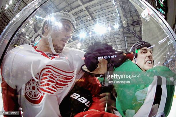 Jonathan Ericsson of the Detroit Red Wings checks Jamie Benn of the Dallas Stars into the glass in the second period at American Airlines Center on...