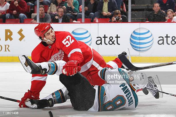 Jonathan Ericsson of the Detroit Red Wings collides with Joe Pavelski of the San Jose Sharks in Game Four of the Western Conference Semifinals in the...