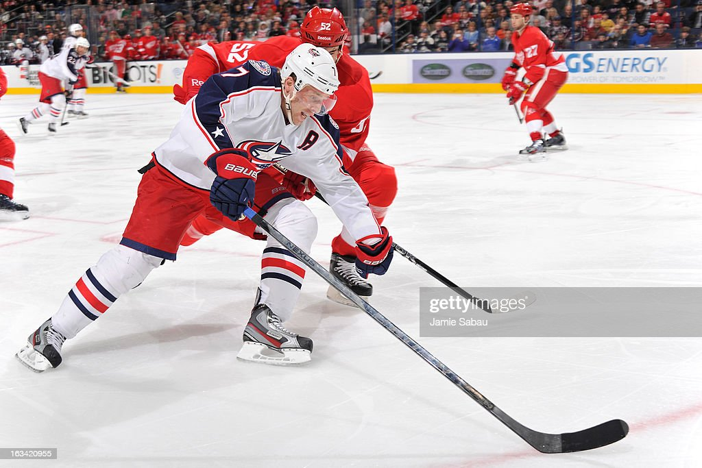 <a gi-track='captionPersonalityLinkClicked' href=/galleries/search?phrase=Jonathan+Ericsson&family=editorial&specificpeople=2538498 ng-click='$event.stopPropagation()'>Jonathan Ericsson</a> #52 of the Detroit Red Wings defends Jack Johnson #7 of the Columbus Blue Jackets during the third period on March 9, 2013 at Nationwide Arena in Columbus, Ohio.