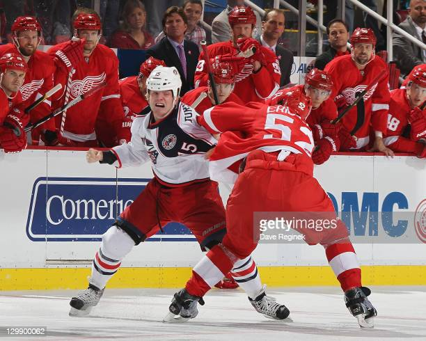 Jonathan Ericsson of the Detroit Red Wings fights with Derek Dosett of the Columbus Blue Jackets during an NHL game at Joe Louis Arena on October 21...