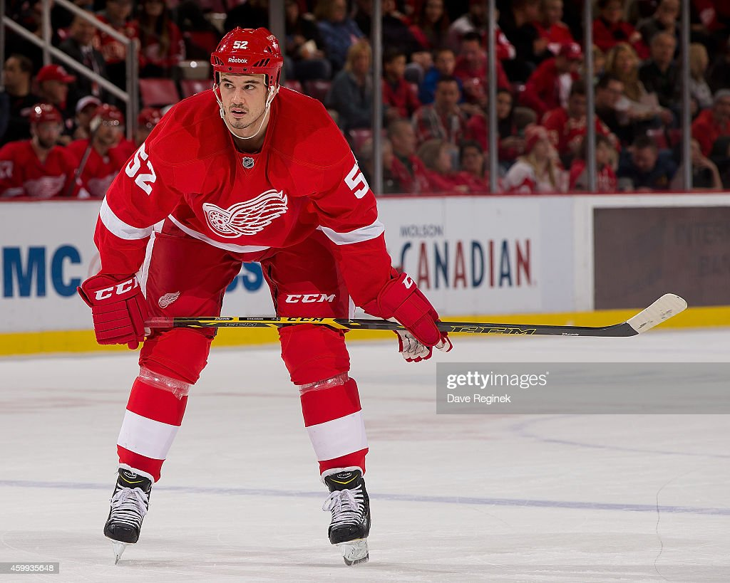 Jonathan Ericsson of the Detroit Red Wings gets set for the faceoff during a NHL game against the Florida Panthers on December 2 2014 at Joe Louis...