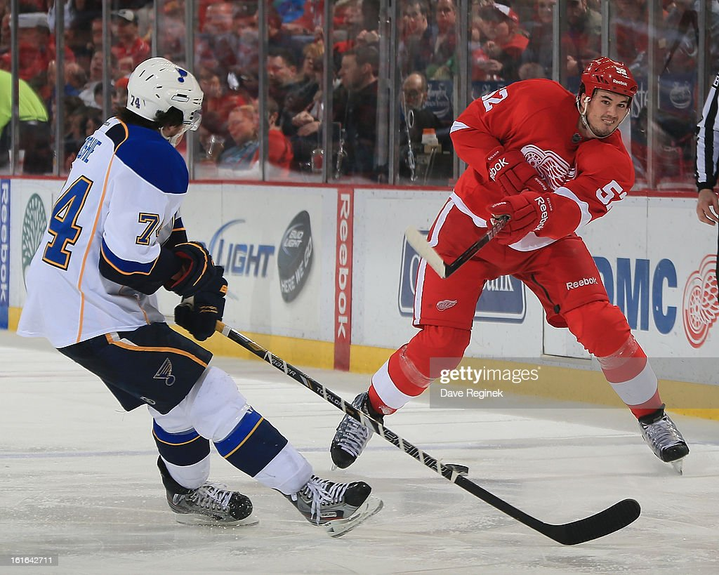 Jonathan Ericsson #52 of the Detroit Red Wings has a shot blocked by T.J. Oshie #74 of the St Louis Blues during a NHL game at Joe Louis Arena on February 13, 2013 in Detroit, Michigan. The Blues won 4-3