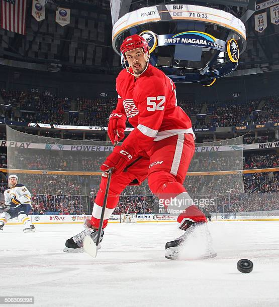 Jonathan Ericsson of the Detroit Red Wings looks to control the puck agains the Buffalo Sabres during an NHL game on January 22 2016 at the First...