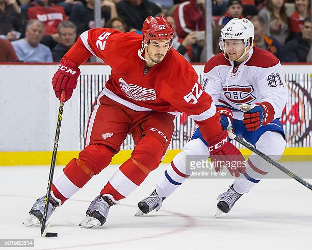Jonathan Ericsson of the Detroit Red Wings protects the puck from Lars Eller of the Montreal Canadiens during an NHL game at Joe Louis Arena on...