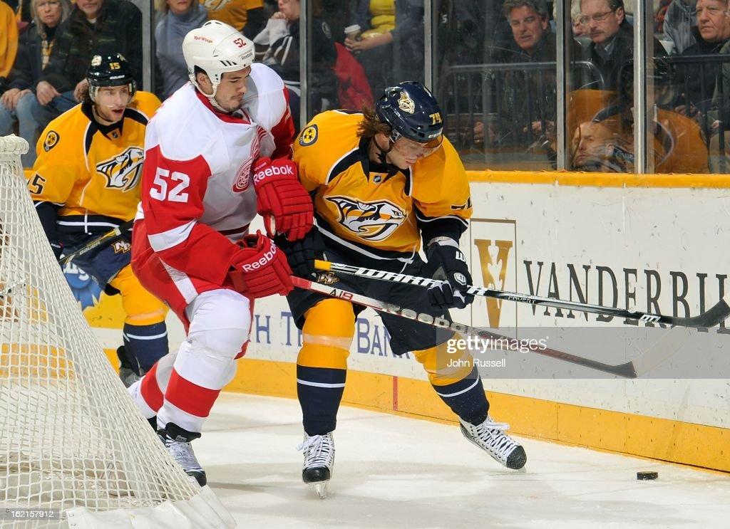 Jonathan Ericsson #52 of the Detroit Red Wings skates against Sergei Kostitsyn #74 of the Nashville Predators at Bridgestone Arena on February 19, 2013 in Nashville, Tennessee.