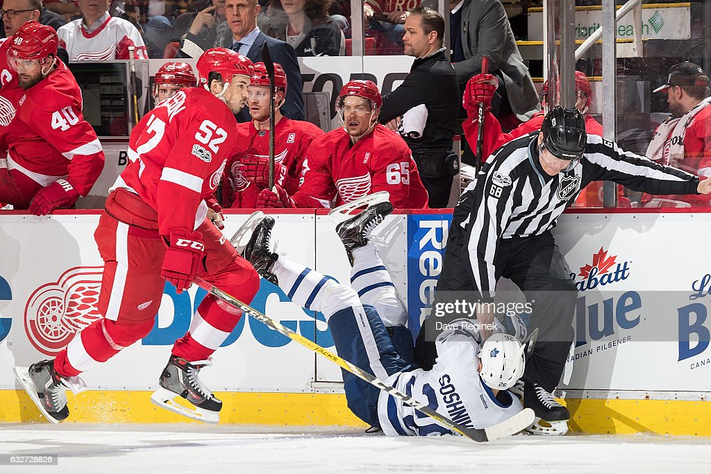 Jonathan Ericsson #52 of the Detroit Red Wings skates behind Nikita Soshnikov #26 of the Toronto Maple Leafs as he crashes into linesman Scott Driscoll #68 during an NHL game at Joe Louis Arena on January 25, 2017 in Detroit, Michigan. The Leafs defeated the Wings 4-0.