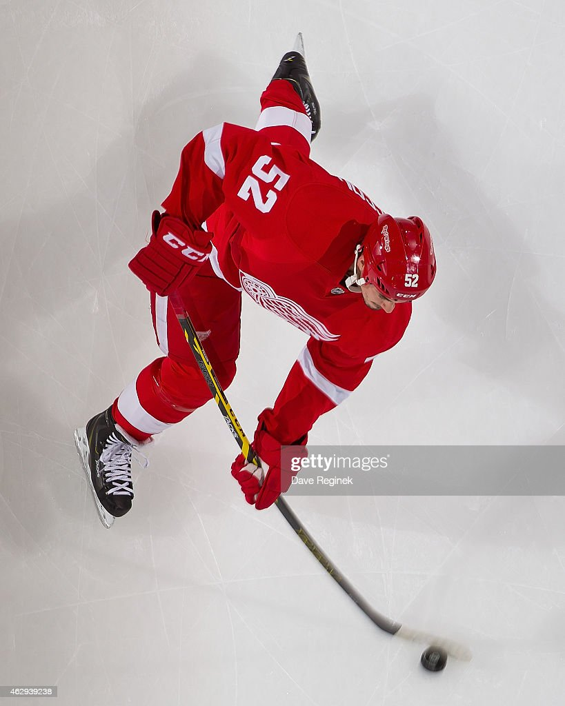 Jonathan Ericsson of the Detroit Red Wings skates in warmups prior to the NHL game against the New York Islanders on January 31 2015 at Joe Louis...