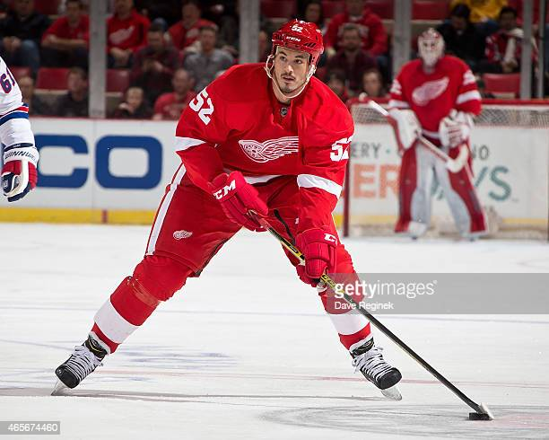 Jonathan Ericsson of the Detroit Red Wings skates up ice with the puck during a NHL game against the New York Rangers on March 4 2015 at Joe Louis...