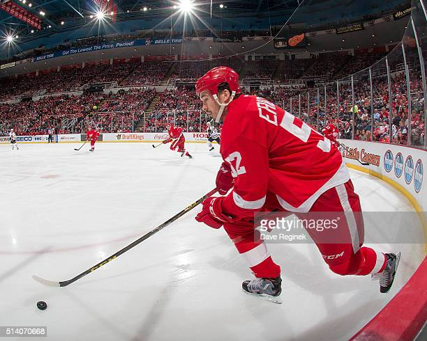 Jonathan Ericsson of the Detroit Red Wings skates up ice with the puck during an NHL game against the Chicago Blackhawks at Joe Louis Arena on March...