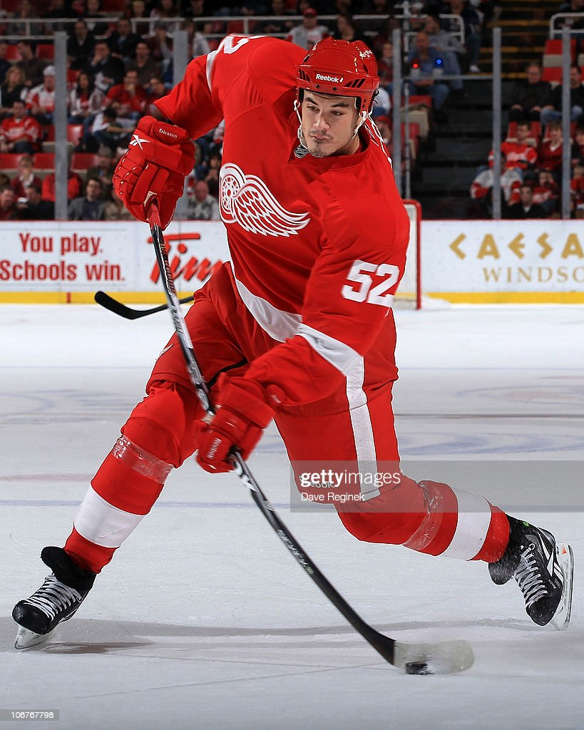 Jonathan Ericsson of the Detroit Red Wings takes a shot during an NHL game against the Edmonton Oilers at Joe Louis Arena on November 11 2010 in...